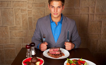 man-at-a-restaurant-eating-steak